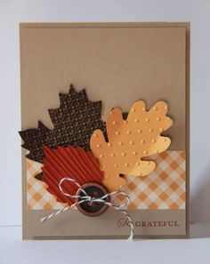 embossed leaves! great for thanksgiving/fall/halloween page, love the little button too! and the checkered background