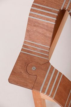 stratflex. Using inlay to fill the holes that are made to shape the wood.