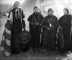 Alex, Katherine, Katherine and Lucy, four Native Americans on the Flathead Indian Reservation in western Montana, stand in front of a teepee on the reservation.