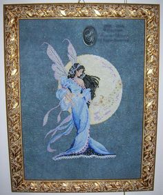 Blue Fairy 1/6 -- for 4 larger charts and larger thread code, click on visit site and click to zoom in.  Then download.
