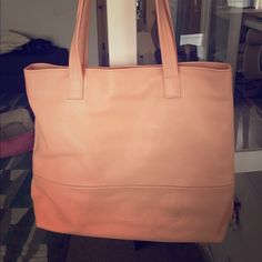 Freshly Picked Coral Leather Bag Limited edition bag made by Freshly Picked (they make baby moccasins). Fun leather bag beautifully made in the USA. Purchased and used once! Coral is much more vibrant than the photos. Feel free to ask questions! Always happy to negotiate the price! Bags