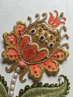 Ornate flower (detail), Silk long and short stitch, goldwork, stumpwork, pearls, beads, check purl. Size: fits A4. Made by Larissa Borodich.