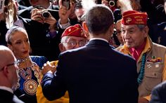 US President Barack Obama greets Peter MacDonald Sr (L) and George James Sr, members of Navajo Code Talkers Association, at the White House Tribal Nations Conference