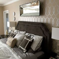 A DIY stenciled bedroom using the Entwined Allover Stencil on an accent wall in metallic silver. http://www.cuttingedgestencils.com/stencil-pattern-2.html