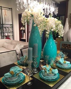 Turquoise Vases with white orchids. Amazing centerpiece.