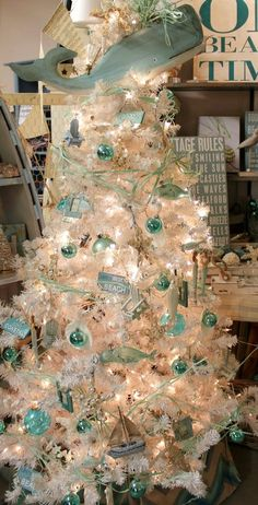 You can crown your Christmas tree with anything! How about a whale as a tree topper? Featured here: http://www.completely-coastal.com/2013/11/white-Christmas-trees-beach-coastal.html (3rd tree from the top).