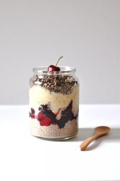 Layered chia pudding with a cherry on top. Vegan and gluten free recipes.