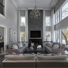 By @joneskeenacompany! #livingroom #familyroom #fireplace #stonefireplace #chandelier #crownmolding #pillows #decorativepillows #homedecor #homedesign #interiordesign #realestate #dreamhome #inspo #decor #beautifulhomes #luxury #goals #follow #design #luxuryhomes #luxuryrealestate