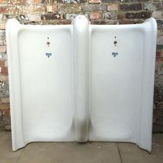 A pair of antique urinals in porcelain. These large pieces of sanitary-ware were created by AdamSez Ltd, who were in operation from This manufacturer supplied sanitary-ware to the London . Victorian Urinals, London Boroughs, Good Dates, Porcelain, Bathtub, Antiques, Public, Bathroom, Vintage