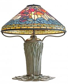 View this item and discover similar for sale at - Exceptionally beautiful Tiffany Studios 'POPPY' table lamp, circa depicting multiple poppies in full bloom, in plum and periwinkle purples, crimson Geometric Table Lamp, Lamp, Geometric Table, Tiffany Glass, Glass Desk, Table Lamp Shades, Beautiful Lighting, Tiffany Lamps, Leaded Glass