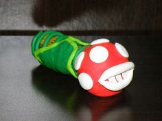 """Nintendo's Piranha Plant Tobacco Pipe Apx. 3"""" Long One of a Kind Hand Crafted Polymer Clay  Glass Lined for the Smoothest, Safest Smoking Experience   New, Never Used  Includes   -2 FREE Glass Screens   -FREE Gift!   -FREE Shipping   Not a random pick. Pictures are of actual item f..."""