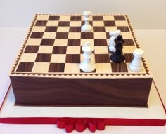 Children's Birthday Cakes - Chess cake with a puzzle: Checkmate by White in two moves.  Caramelized apples and Bavarian mousse.  Modeling chocolate decorations.