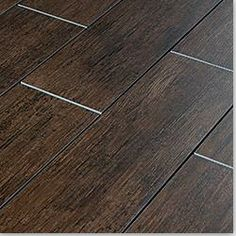 Tiles that look like hardwood. Darker in kitchen and living room, the lighter version in the bathroom.