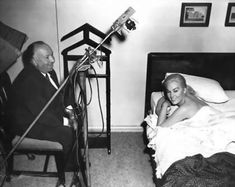 "Alfred Hitchcock & Kim Novak chuckle on the set of ""Vertigo""."