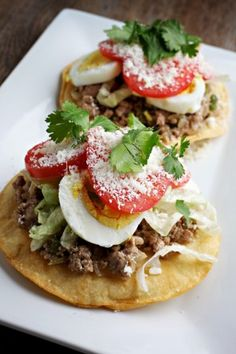 These resemble Mexican tostadas, because the tortilla is crisped and the filling is presented as a topping. These resemble Mexican tostadas, because the tortilla is crisped and the Mexican Enchiladas, Mexican Tostadas, El Salvador Food, Salvadoran Food, Recetas Salvadorenas, Good Food, Yummy Food, Comida Latina, Gastronomia