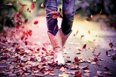 Oh yeah! Fall leaves, skinny jeans and cowgirl boots.