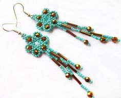 Free pattern for beaded earrings with fringe Marcela   U need: seed beads 11/0 bugles faceted round beads 4 mm