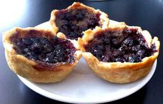 Saskatoon berry butter tarts - also official Saskatoon association website --- i tried making these but the filling did not set for me, so i just had a soupy mess! it was tasty! but disappointing. Saskatoon Recipes, Saskatoon Berry Recipe, Tart Recipes, Sweet Recipes, Baking Recipes, Tart Shells, Butter Tarts, Recipe Using, Just Desserts