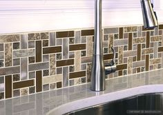Possibly too busy for the whole backsplash, but I LOVE the mixed media look.