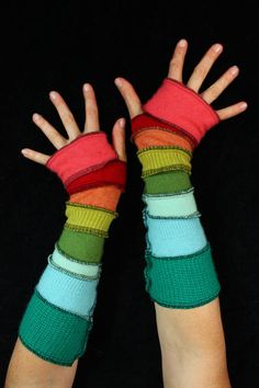 Here is a great pair of arm warmers made from bits of recycled knits. They have a vivid palette of bold rainbow. Best of all, theyre a 100% cashmere.   Enjoy!  ************************************************************************************************************  About Katwise Sweaters:  I started making recycled patchwork hoodies 20 years ago, while I was a wee gypsy girl, following the Grateful Dead. Since then my style has evolved and grown into this etsy maddness. I have made…