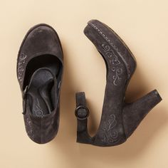 SILVANA SHOES BY BORN CROWN--A flourish of embroidery is the femme finale on these high-rise platforms. They're hand sewn in Italian suede with calfskin lining and a contoured latex footbed for unexpected arch support and wear-to-work comfort. Whole and half sizes 6 to 10