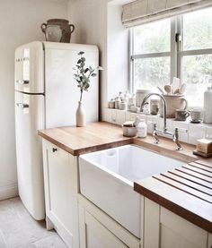 Love Joanna Gaines's style aesthetic? Flip through for homes that have that same… Love Joanna Gaines's style aesthetic? Flip through for homes that have that same…,Home Love Joanna Gaines's style aesthetic? Flip through for. Smeg Kitchen, Kitchen Appliances, Smeg Fridge, Retro Fridge, Farm Sink Kitchen, Kitchen Islands, Room Kitchen, Kitchen Dining, Brass Kitchen