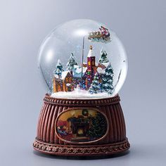 サンタクロースがくるくる回る、にぎやかなスノーグローブ。【スノードームオルゴール/サンタ】