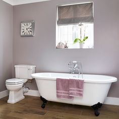 Bathroom with classic roll-top bath and deep grey walls