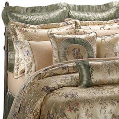 This charming floral bedding has lovely woven Iris flowers against a satin-like background. Bouquets of lavender and apricot colored flowers on a gold and green stemming vine are accented with crinkled satin.