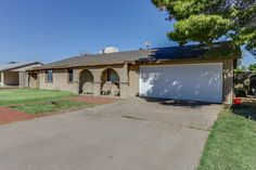 Charming 4 Bedroom, 2 Bathroom Home w/ Mountain Views!!!  Large Backyard, Updated Kitchen and Baths, and Arizona Room!! Covered RV parking, Attached Garage, and Storage Shed! $160,000