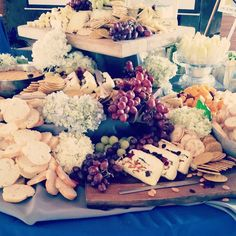 This is how we do cheese platters - Humnboldt Fog, Brie, Gouda, Port Salut, Manchego and St. Andre. Served with Crackers, Grapes, Dried Fruits and Nuts.