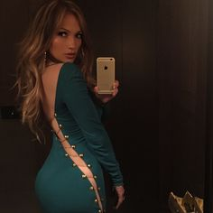 Jennifer Lopez photographing her butt in a skin tight pin dress and then sharing said photo with the Internet