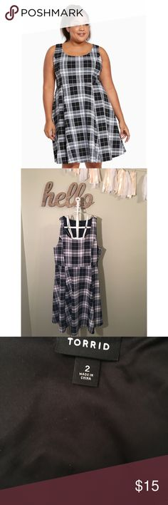 Retro chic plaid skater dress Nice stretch fabric. Machine wash. Only worn a few times.  bust 26 waist 42  Length 25 inches from waist seem torrid Dresses