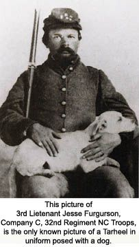 Believed to be the only known photo of a North Carolina Civil War soldier in uniform with a dog. He is 3rd Lt. Jesse Furgurson, Co. C, 32nd Regiment, North Carolina Troops.