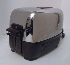 Working GE Chrome Bakelite Vintage 169T81 General Electric Mid Century Toaster http://www.medusamaire.com/my-ebay-items/ to see all of Medusa Maire's items for sale!