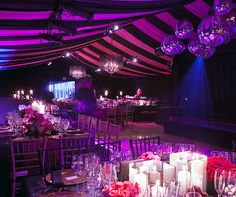 A sultry ambiance is achieved through a mix of pillar candles, enclosed chandeliers and spotlights.