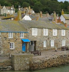 """17th-century stone house in West Cornwall is called """"The Oyster Catcher."""" It sits right on the water in a tiny fishing village called Mousehole, and you can rent it for vacations."""