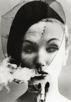 William Klein: Smoke and Veil, Paris (Vogue), 1958. Silver gelatin print. Model: Evelyn Tripp.