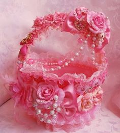 Decorated pink ribbon and lace basket