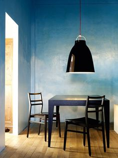 """I love the blue wall, though I wish it was less """"cloud-like"""". especially contrasted w/ the black over-sized pendant lamp"""