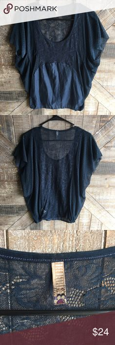 Sheer Navy Free People Top Sheer lace Navy Blue Free People Top in good used condition. Size medium. No trades, reasonable offers through offer button. Free People Tops Blouses