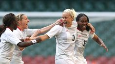 The Great Britain women's football team kicked off the 2012 Olympics with a hard-fought victory over New Zealand.