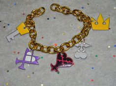Kingdom Hearts Charm Bracelet Pick gold or silver by thekidicarus, $12.00