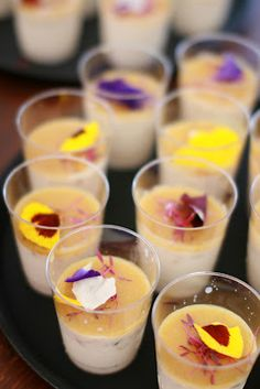 roasted corn panna cotta w. quince sauce & edible flowers.