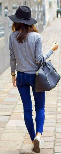 Women's' Black Wool Hat, Grey Long Sleeve T-shirt, Blue Skinny Jeans, Black Leather Tote Bag, and White Low Top Sneakers