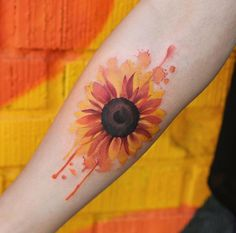 37 The watercolor sunflower tattoo on the forearm for men