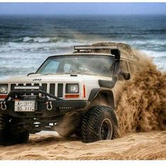 62 best grand cherokee zj images on pinterest jeep truck pickup jeep cherokee kickin up sand on the beach fandeluxe Image collections