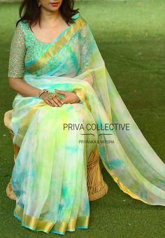 PV 3506 : Blue Green shaded organza Price : This festive season bring back the classic look in this tie and dye organza sari in colours that spell elegance Unstitched blouse piece - Sea green sequins work net blouse piece as shown in the picture For Order Half Saree Designs, Saree Blouse Neck Designs, Saree Blouse Patterns, Designer Blouse Patterns, Trendy Sarees, Stylish Sarees, Fancy Sarees, Simple Sarees, Chiffon Saree