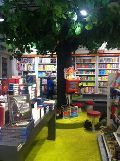 Love having a tree in the children's section.  Maybe with fairy lights.  And an open placed underneath for storytime and looking at books.  The children's section of a bookstore in Frankfurt.
