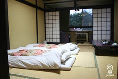 布団 - Futon  Traditional style of Japanese bedding consisting of padded mattresses and quilts pliable enough to be folded and stored away during the day, allowing the room to serve for purposes other than as a bedroom.